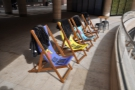 At the far (left-hand) end, there are more deckchairs, each with its own fur coat...