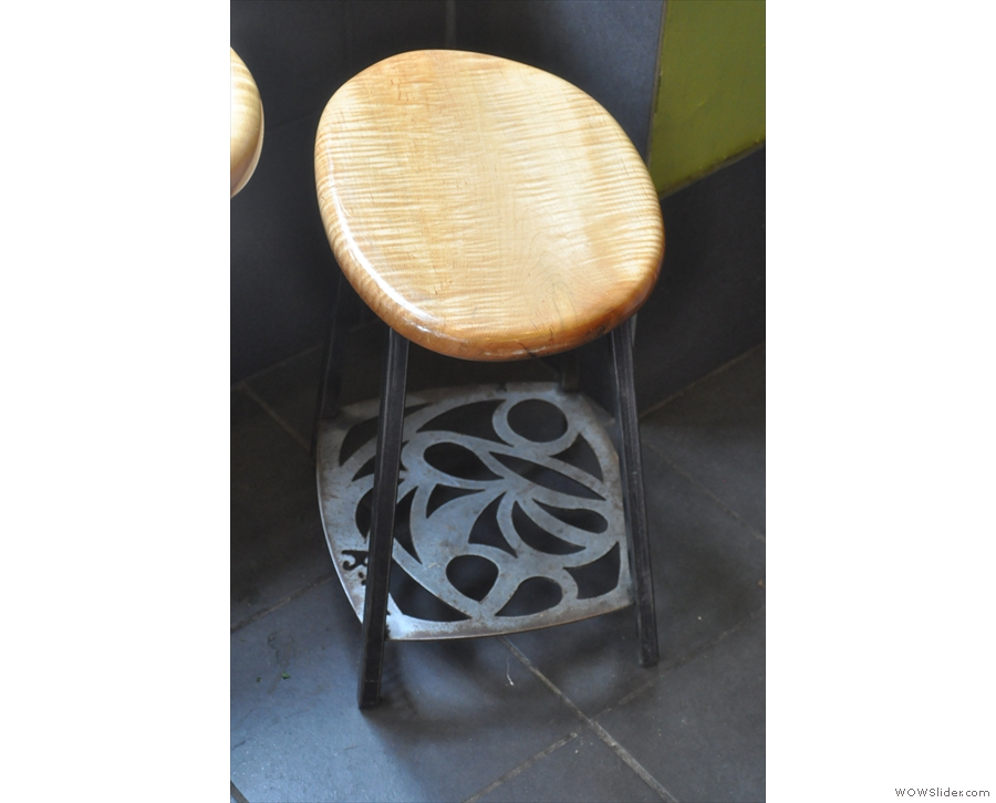 A similar motif continues on the base of the stools.