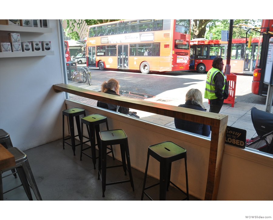 The window-bar on a sunny May morning. The buses were out in force.