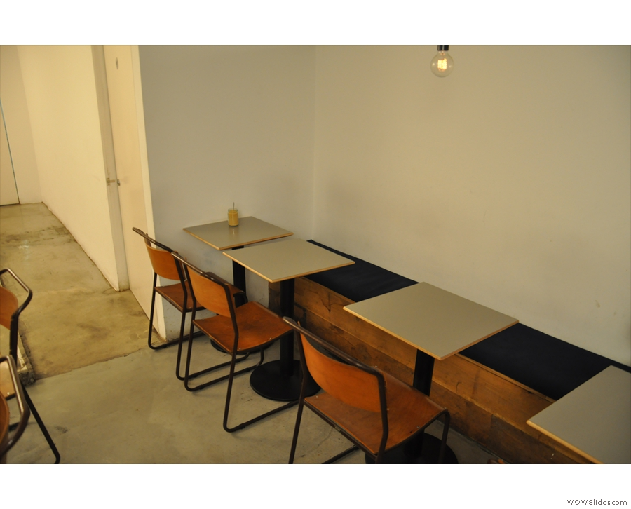These tables, along with their padded bench, are along the right-hand wall...