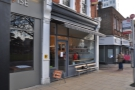 Ealing's Electric Coffee Company, opposite the bus stand and just down from the station.