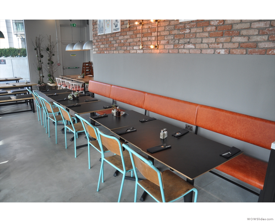 There's this long row of bench seats on the back wall beyond the kitchen.