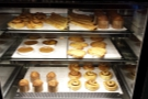 The well-stocked pastry shelves first thing in the morning...