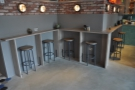 The bar on the far wall continues around the corner...