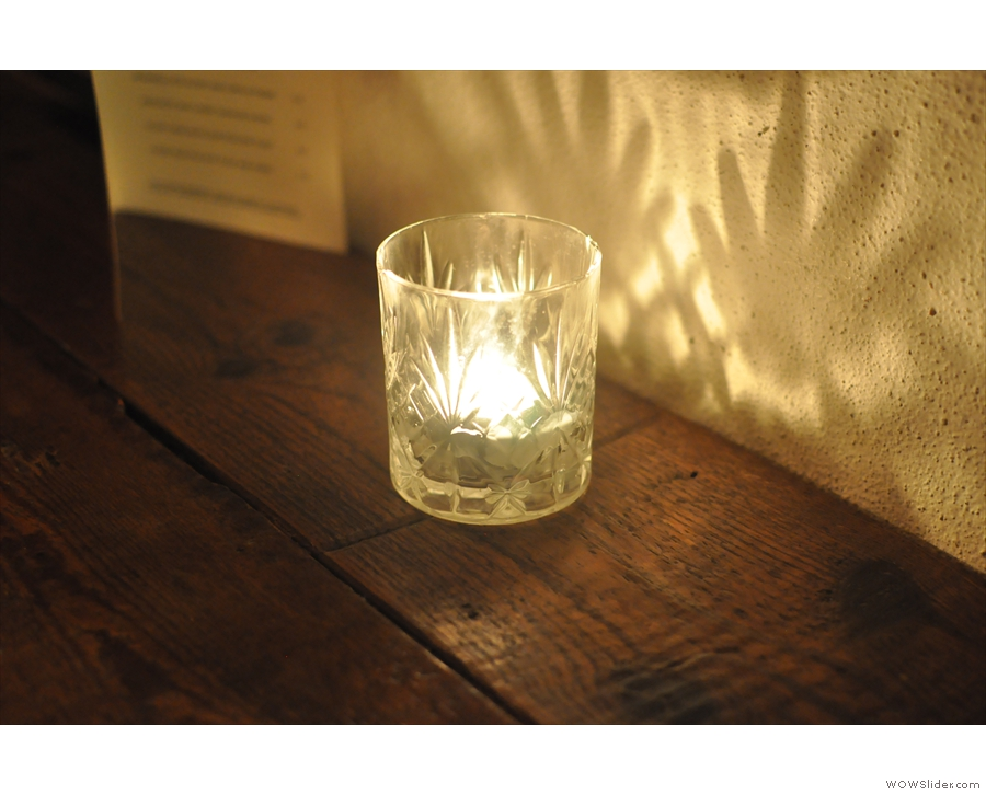 ... by these lovely candles, which sit inside glasses.