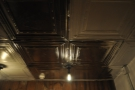 Meanwhile, the basement has a wonderful, tin ceiling. With its own light-bulbs...