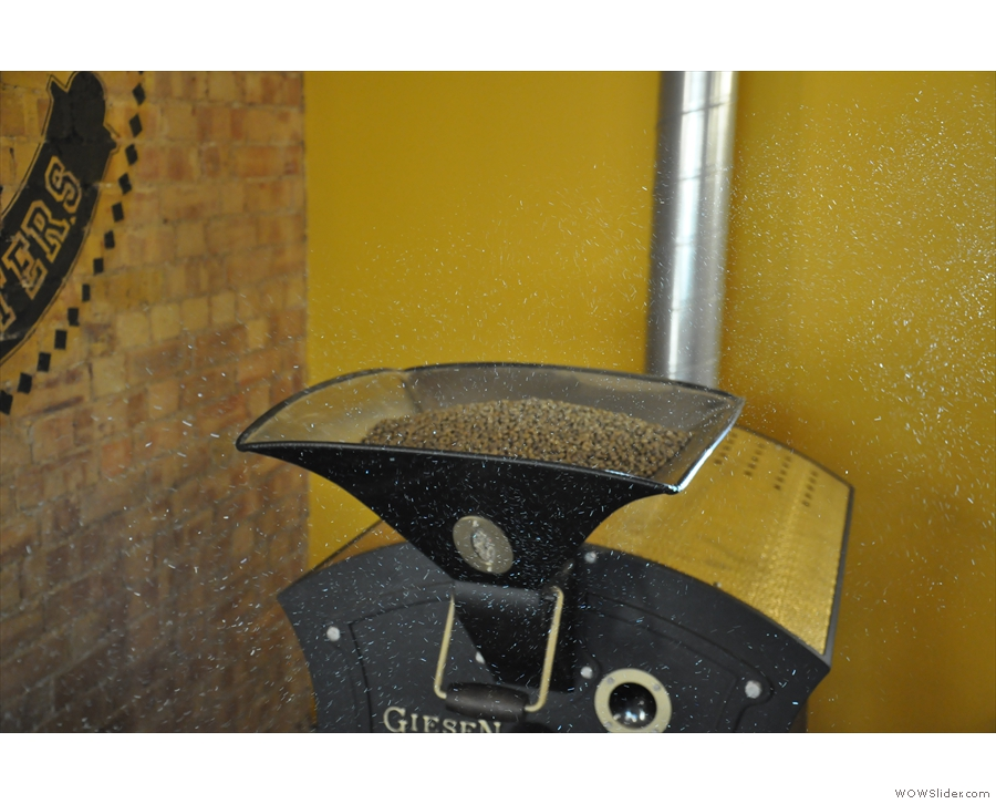 Next, put them in the top of roaster. The white flecks are dust caught in a shaft of sunlight.