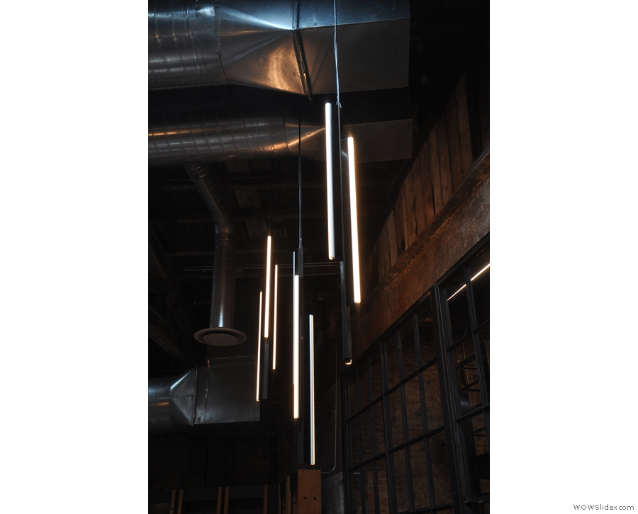 Meanwhile, at the back, these lovely lights hang from the ceiling.