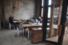 ... starting with this cluster of tables by the window.