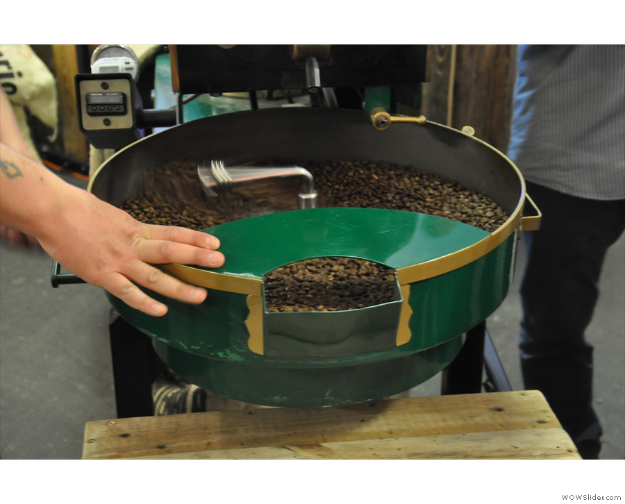 Meanwhile, James keeps cooling the beans, in this case by hand-cranking the pan!
