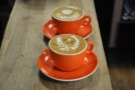 More gorgeous latte art. Don't you just love the orange cups?
