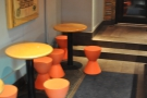 There's not much in the way of seating. These orange stools and round tables are at the front, opposite the cakes. There are three tables in all and that's where you will usually find me.