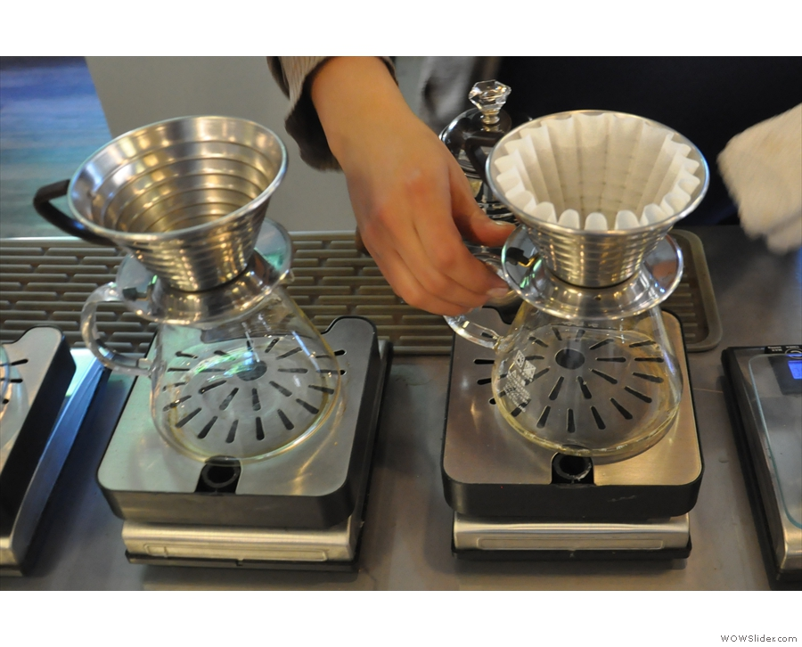 I'll leave you with a Kalita Wave brewing demonstration from Andrea. First, zero the scales.
