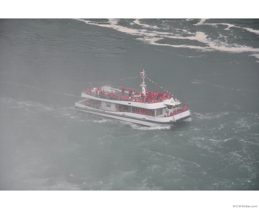 One of the many boats which venture into the spray beneath the falls. This is a Canadian one.