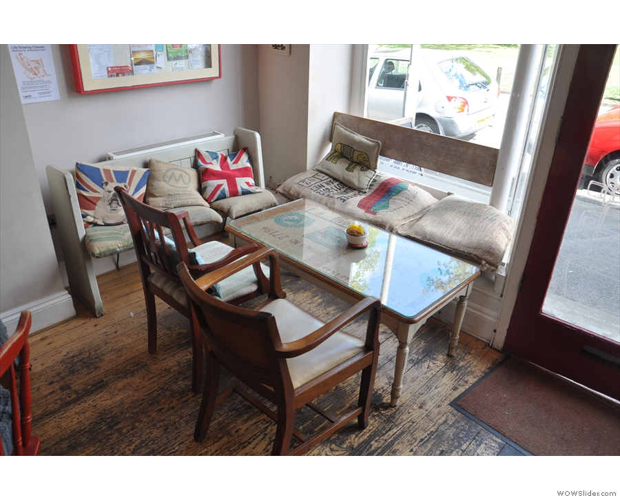 There's a choice of seating: this lovely table in the window to the right of the door...