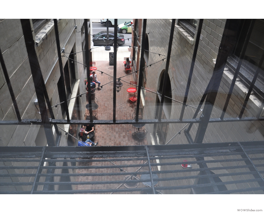 A view of the alley, looking down from the balcony above the shop.