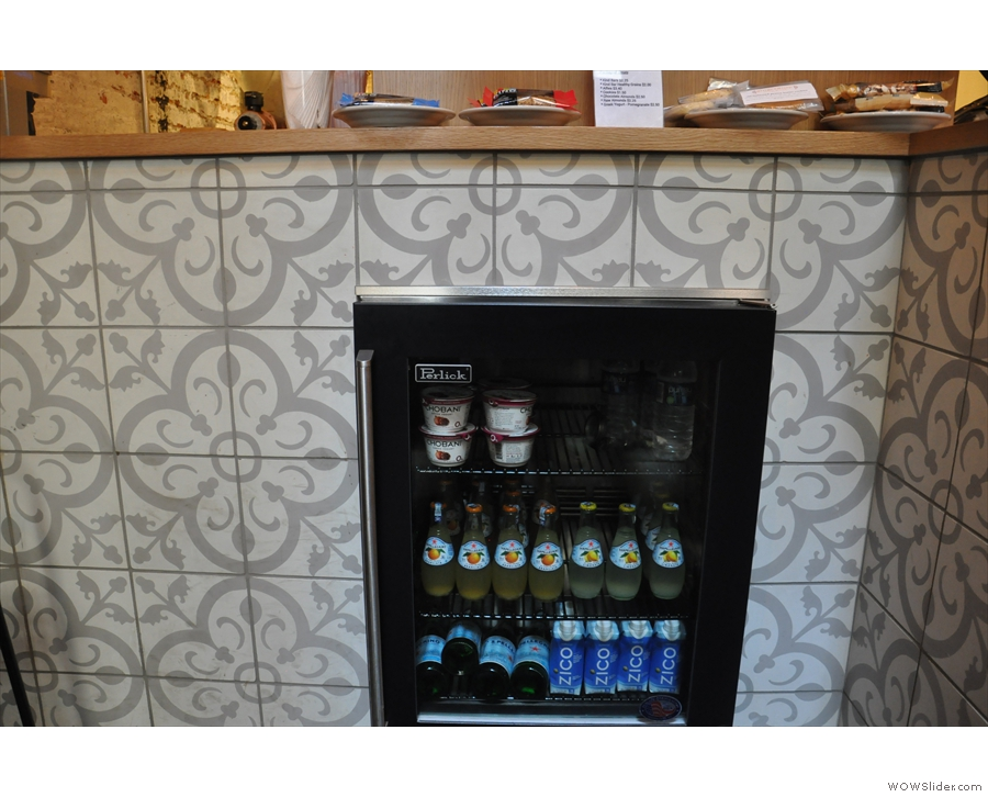Detail of the beautiful tiling on the counter, plus the soft drinks fridge.