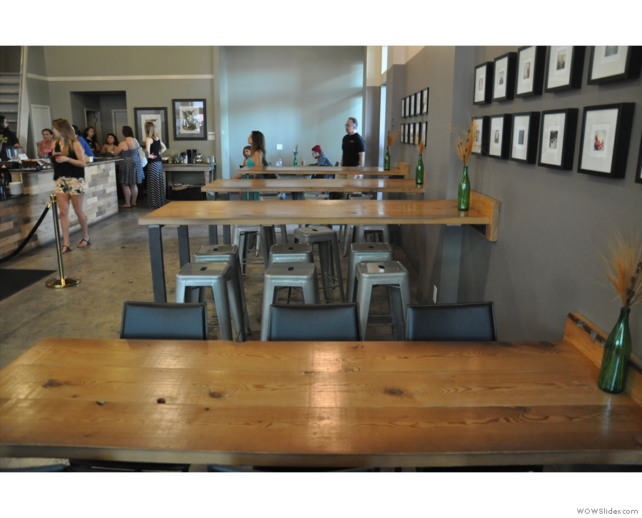 The seating, rows of communal tables, is opposite the counter.