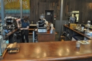 If you want to, sit at the end of the counter, with a view of both espresso machine & brew bar.