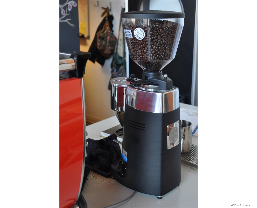 On the other side, there's a third grinder for decaf.