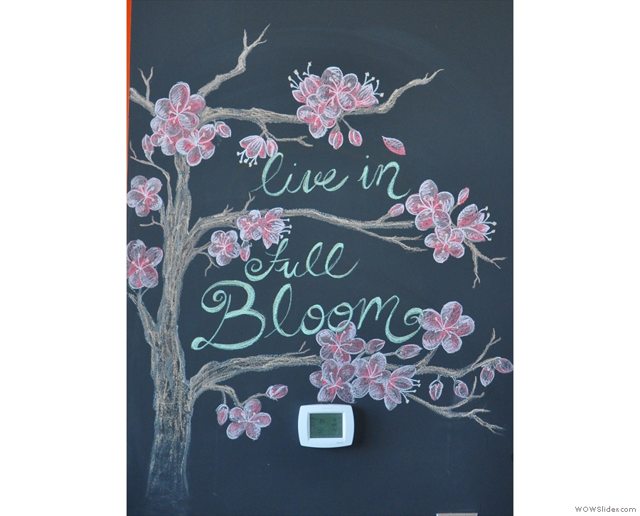 This lovely chalk-drawing is on the wall around the corner from the counter. Good slogan.