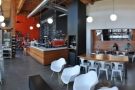 A panoramic view along the length of Stoked, looking from the roaster back to the door.