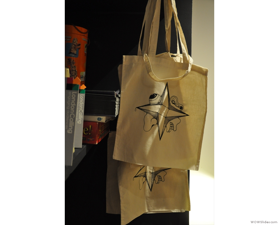You can buy prints and original works. Or, if you like, tote bags...