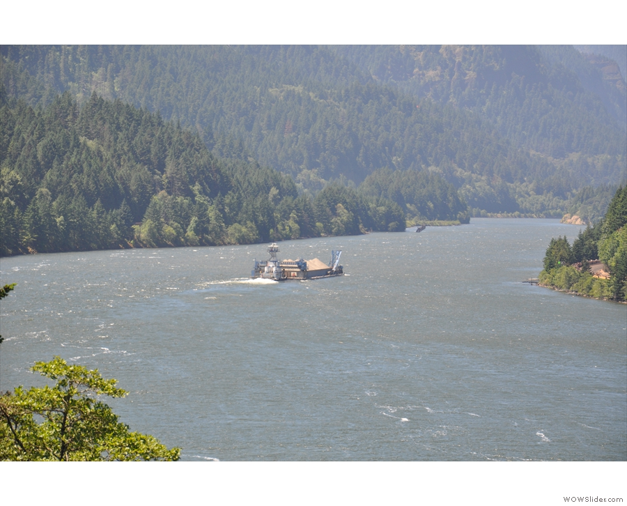 It's a tug, pushing barges. They're not as prevelant as trains, but it's a working river.