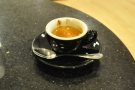 The Gracenote as an espresso in a classic black cup.