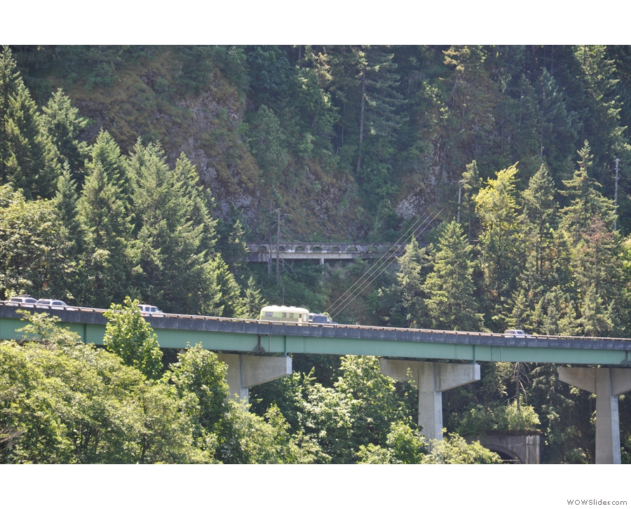 I-84 and the road it replaced, the Columbia Gorge Highway, clinging to the rock face.