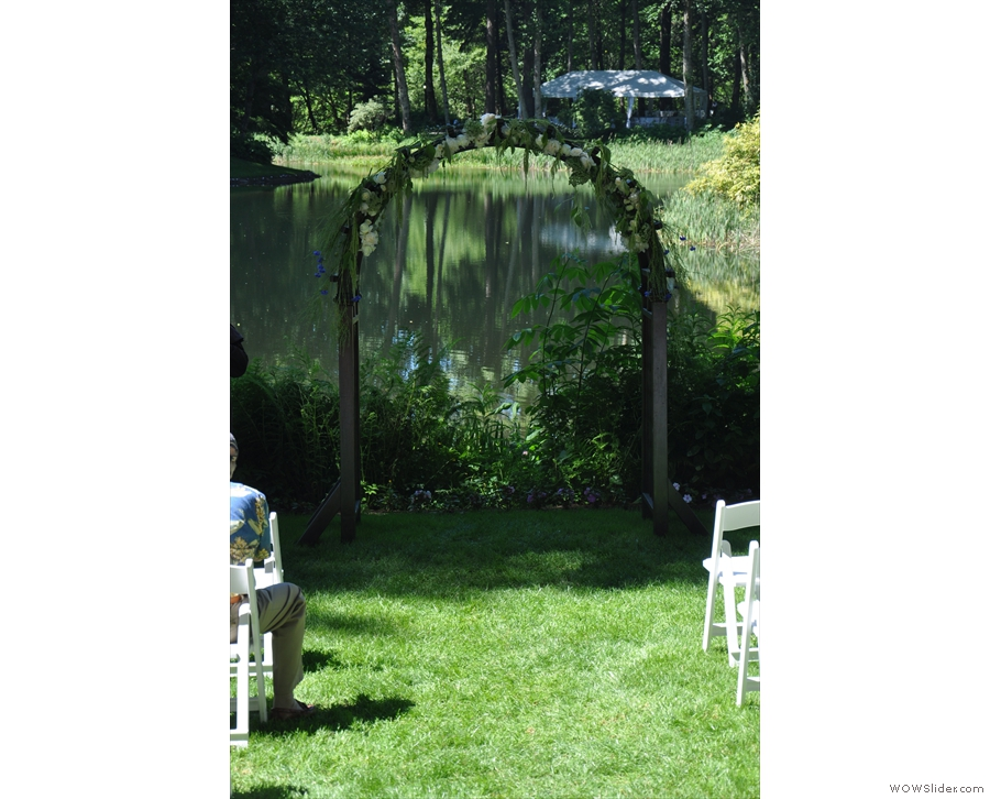 The ceremony took place in front of this simple arch by the lake.