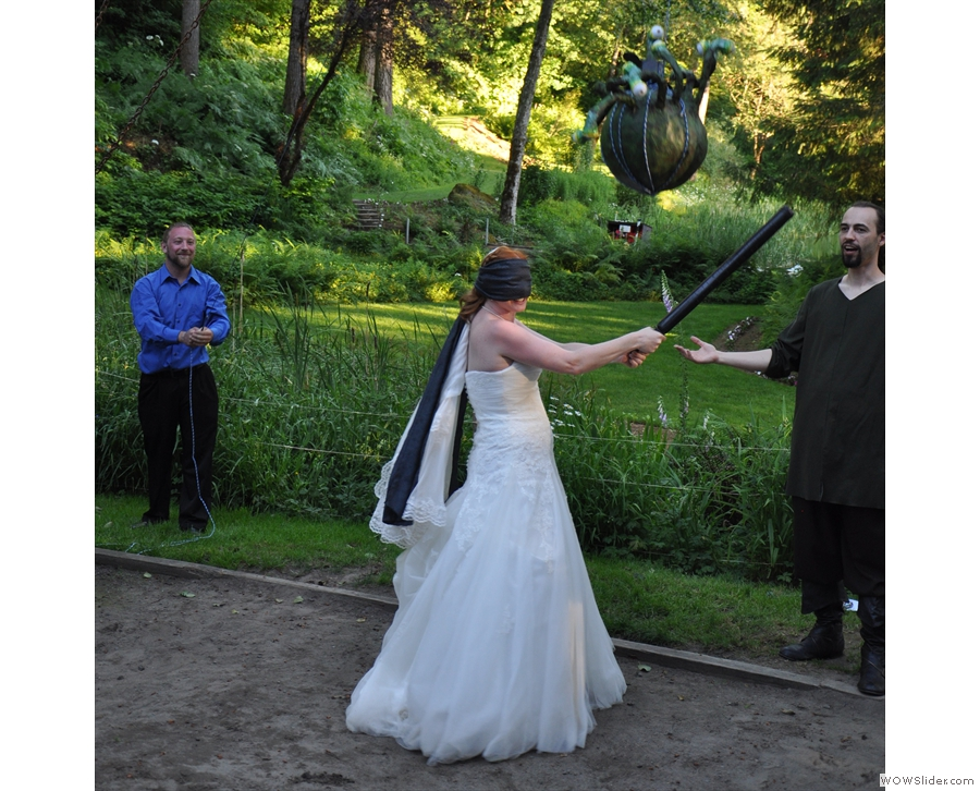 Brian seems unimpressed with his bride's piñata hitting skills! Careful, she's still got the bat!