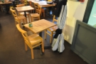 ... and this two-person square table to the right by the side door.