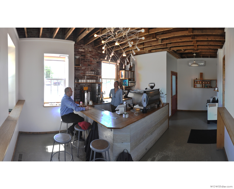 A panoramic view of the coffee bar from the far corner. You can sit at the counter...