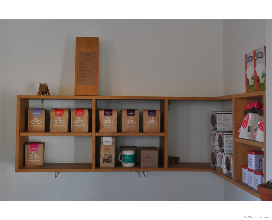 The nook holds Tandem's retail shelves. There are coffee beans for sale here...