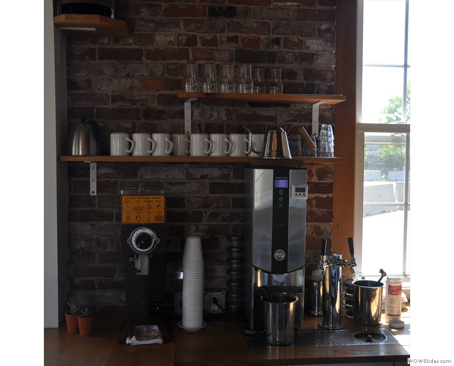 The grinder and boiler for the pour-over is behind the counter, with cold-brew on tap too!