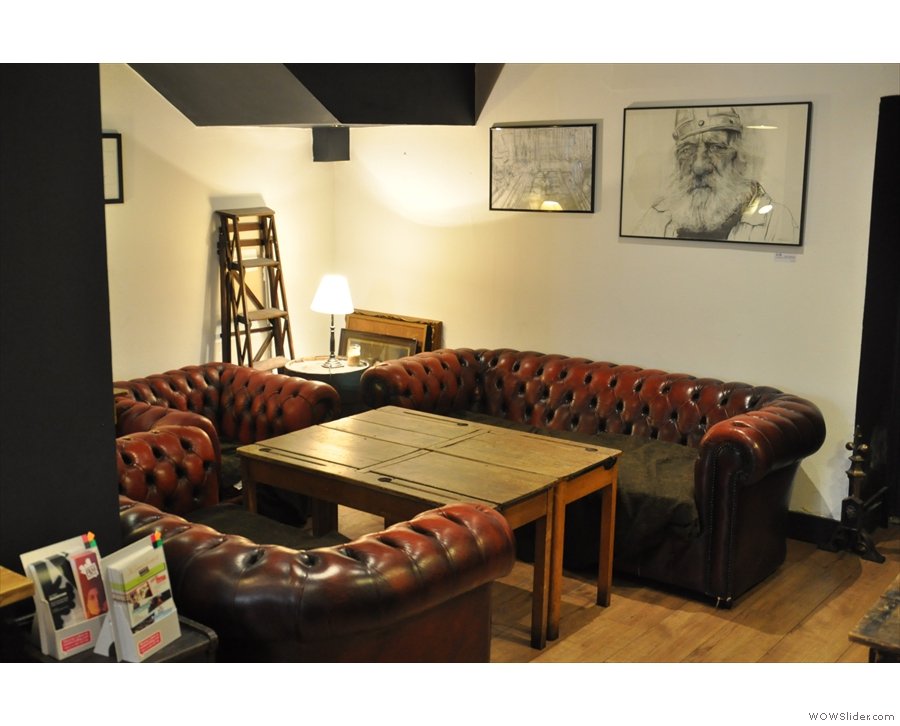 I was particularly taken by this pair of sofas and the armchair in the corner.