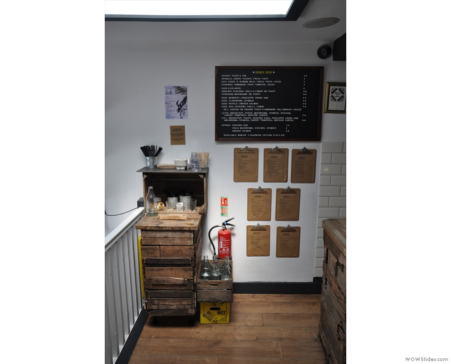 Talking of which, I should order. The menus are up on the wall at the end of the counter.