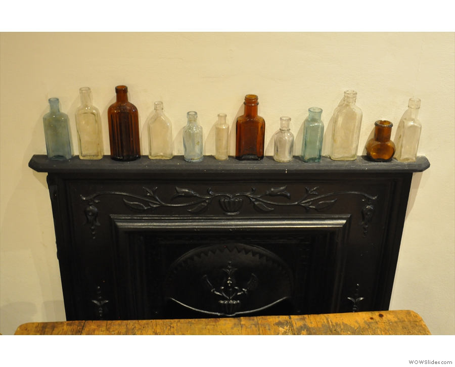 It's not just art: these bottles are on a shelf above the fireplace downstairs...