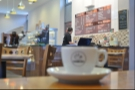 My somewhat out-of-focus espresso watches Andy at work...