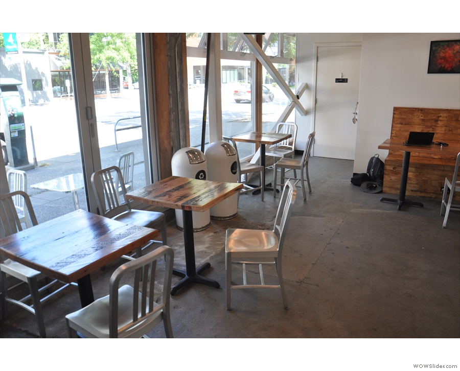 The rest of the seating is in the shape of small, square tables running along the windows.