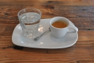 ... then you collect your coffee. It's beautifully presented, with some water, on a china tray.
