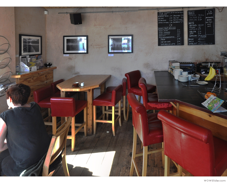 There's also a high table in the corner & another set of bar-chairs at the end of the counter.