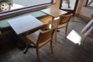 Some of the tables lining both sets of windows.