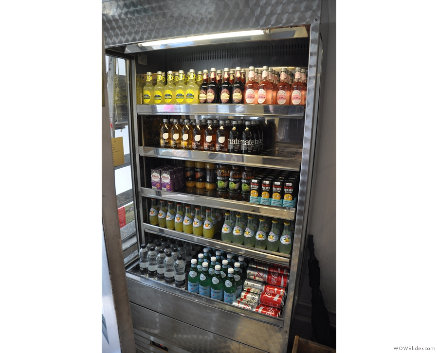 There are soft drinks in a fridge by the door...