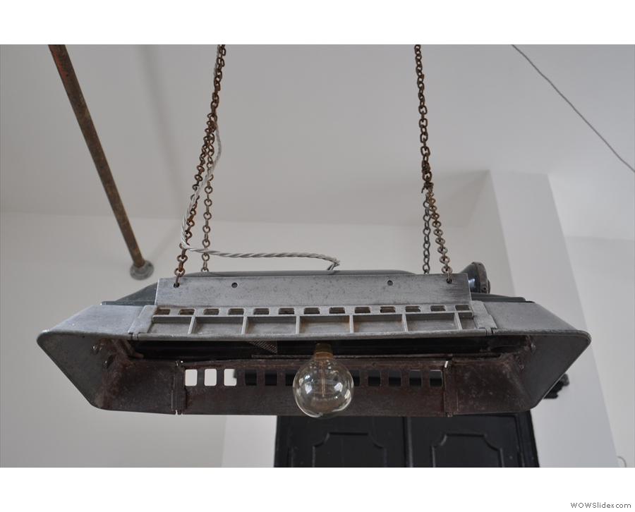 A closer look at one of the two light-fittings hanging above the central table.