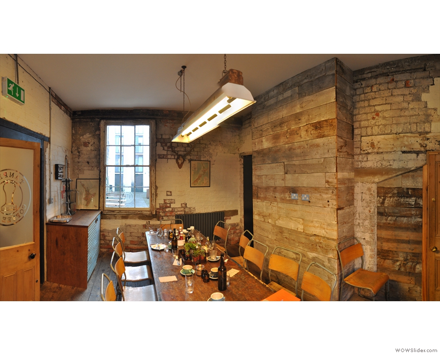 It's this lovely, wood- and brick-clad room, which can be used for meetings.