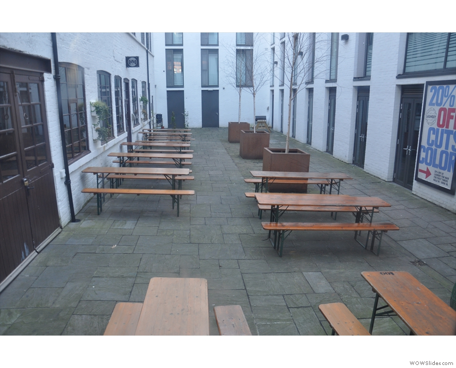 ... and you'll find a whole courtyard, complete with picnic tables! Great for when it's warmer.