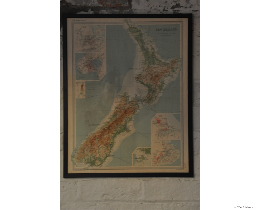 ... and a map of New Zealand hanging on the wall, somewhat giving away Tamper's origins.
