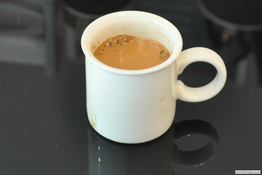 The end-result, an espresso made in one of the two cups Guerra keeps on the top of the machine just for people like me!